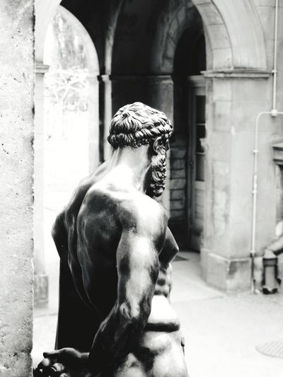 what does he see Natural Structures Blackandwhite Stone Material Atmospheric Mood Still Life Backgrounds Structures Shadows & Lights EyeEm Best Shots EyeEm Selects EyeEm Best Edits EyeEm Best Shots - Black + White Monochrome Sculpting A Perfect Body Sculpture Potsdam Park Sanssouci Statue Sculpture Architecture Historic History Human Representation Sculpted Exterior Colonnade Historic Building