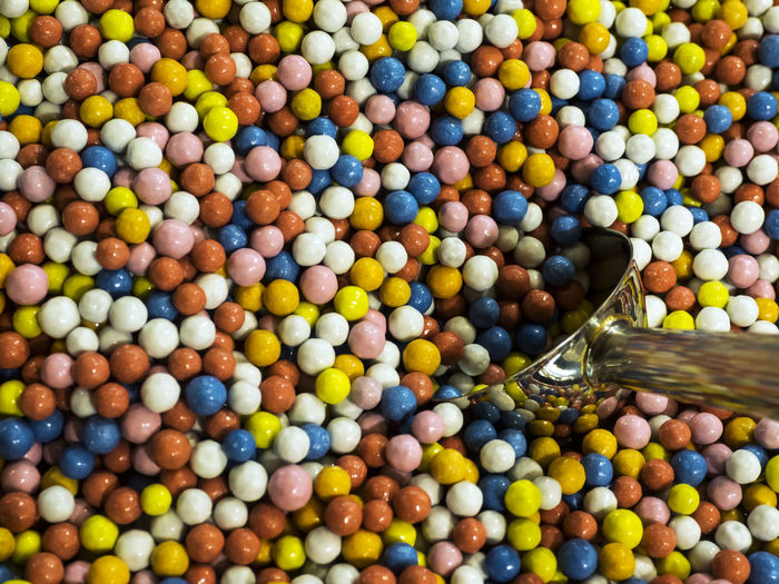 Full frame shot of colorful candies with spoon