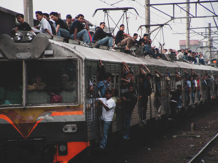 In the past, many people were going to office using train not only inside, but also at the roof. of course this is risk their life. Group Of People Crowd Large Group Of People Real People Transportation Men Mode Of Transportation Rail Transportation Adult Women Public Transportation Lifestyles Train - Vehicle Track Standing Crowded Crowded Train Crowded People Peak Season Traffic Traffic Train