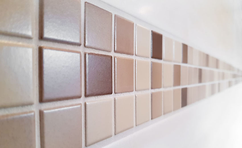 Colse up of modern mosaic tiles on wall - selected focus - narrow depth of field Indoors  White Color No People In A Row Selective Focus Simplicity Close-up Shelf Brown Pattern Architecture Order Business Arts Culture And Entertainment Retro Styled Copy Space Absence Wall - Building Feature Mosaic Tilers Bathroom