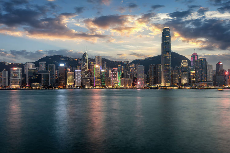 View to the illuminated skyline of Hong Kong just after sunset time Building Exterior Architecture Built Structure City Sky Building Waterfront Water Cityscape Urban Skyline Financial District  Tall - High Skyscraper Outdoors Office Landscape HongKong Hong Kong China City Skyline Sunset Evening ASIA Victoria Harbour