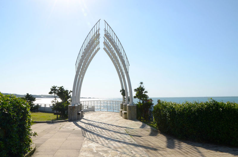 Architecture Blue Bridge - Man Made Structure Built Structure Clear Sky Day Horizon Over Water Nature No People Outdoors Sea Sky Sunlight Taiwan Tree Water 台灣 石門婚紗廣場