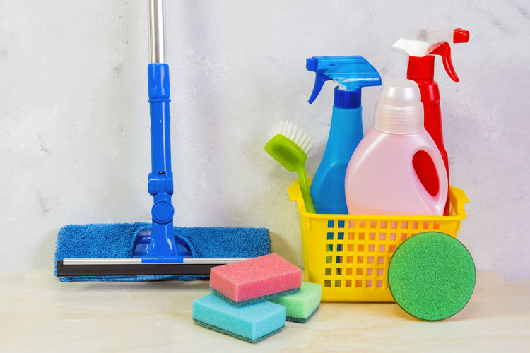 A cleaning kit with tools and products at home. Day of cleanliness. Blue Bottle Chores Cleaning Cleaning Equipment Day Housework Hygiene Indoors  Möp No People Plastic Sand Pail And Shovel Spray Bottle Washing