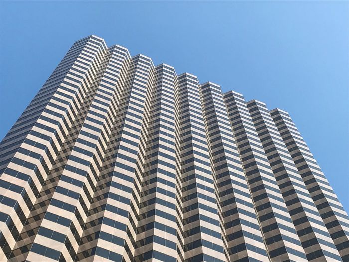 Repetition. Low Angle View Building Exterior Sky Built Structure Architecture Pattern Clear Sky Day No People Building City Tall - High Repetition Office Building Exterior In A Row Modern Tower Outdoors Sunlight