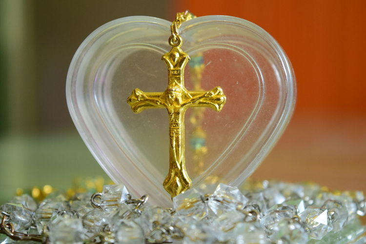 Close-Up Of Rosary Bead With Heart Shape Container