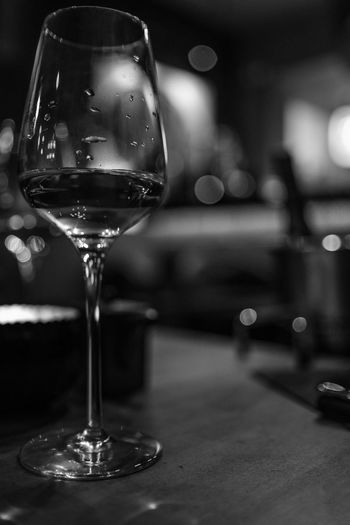 Refreshment Glass Drink Focus On Foreground Food And Drink Table Alcohol Transparent Indoors  No People Glass - Material Close-up Still Life Wineglass Drinking Glass Wine Freshness Restaurant Black And White Droplet Copy Space Vertical Fine Dining Light And Shadow Bar - Drink Establishment