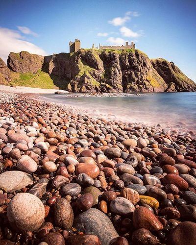 Hall Bay - I've wanted this shot for a long time, a great view of the castle with a beautiful beach and colourful pebbles. Experimented with long exposure shot, using a 10-Stop B+W filter to block the strong midday sun. Dunnottar Dunnottarcastle Dunnottar2016 Aberdeeninstameet Beautiful Pebbles Sunshine Beach Hallbay Longexposure B +w Coastline Stonehaven Beautifulscotland Visitaberdeen Visitaberdeenshire VisitScotland Brilliantmoments EyeEm Best Shots EyeEm Nature Lover The Great Outdoors - 2016 EyeEm Awards