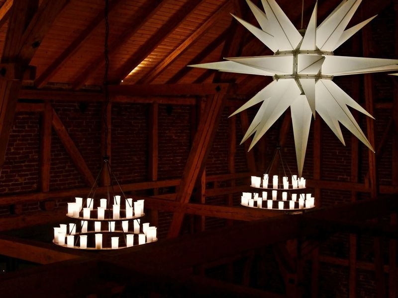 Barn Chandeliers Christmas Star Architecture Built Structure Ceiling Day Electricity  Hanging Illuminated Indoors  Lighting Equipment Low Angle View No People Roof Beam Wood - Material