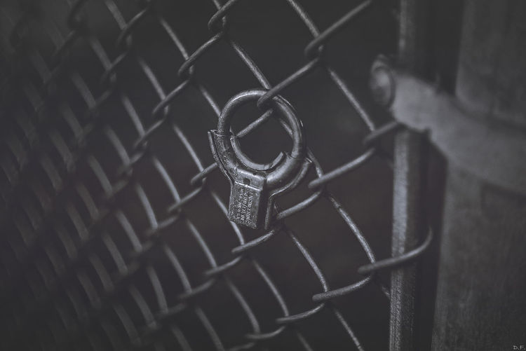 Close-Up Of Lock On Chainlink Fence
