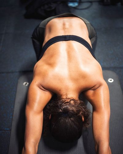 High angle view of young woman exercising in gym