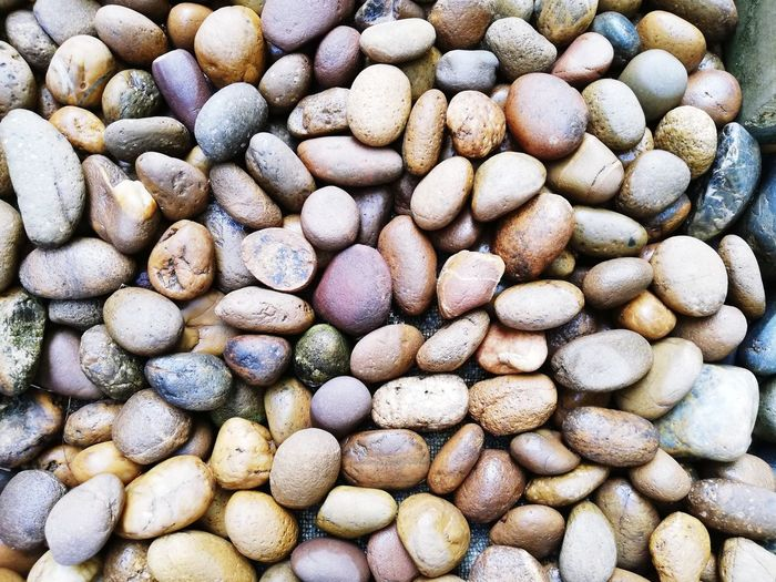 Pebbles in the garden for decoration. Design Stone Garden Outdoor Black Pebble EyeEm Selects Pebble Beach Beach Backgrounds Full Frame Pebble Close-up Stone - Object Stepping Stone Rough Textured  Natural Pattern