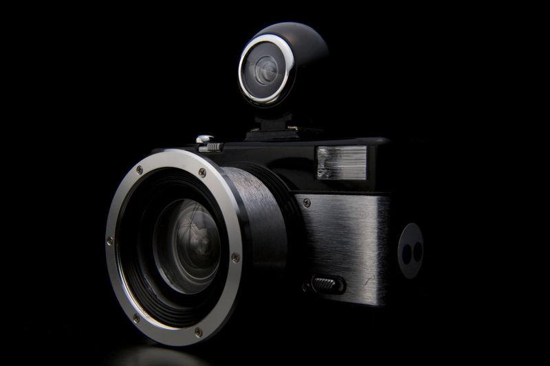 Close-up of camera over black background