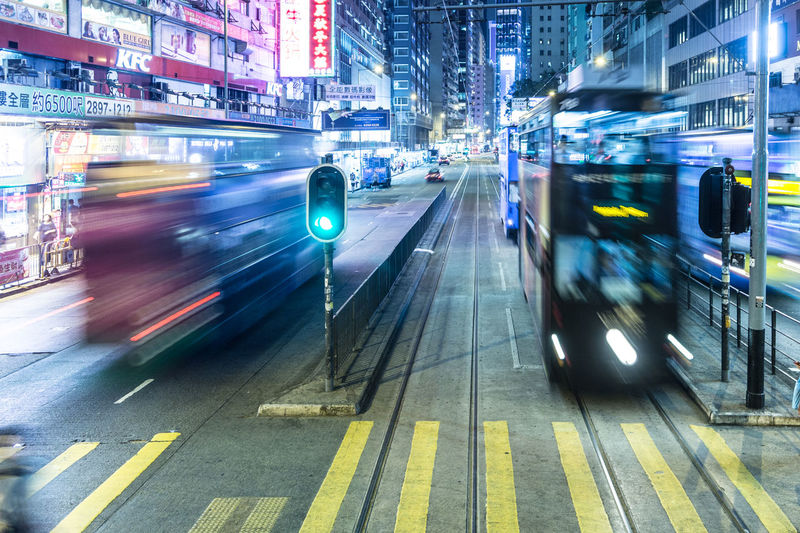 Blurred motion of cars on road in city at night