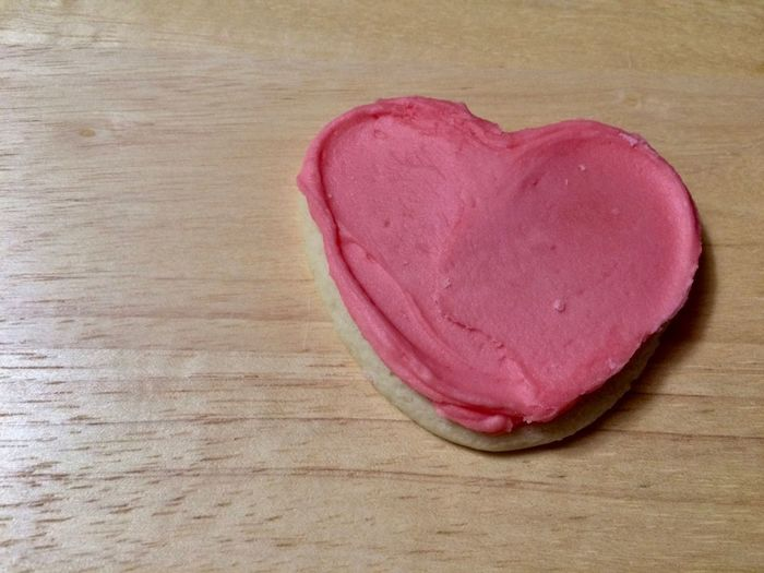 pink heart cookie on wooden background Heart Shape Positive Emotion Emotion Table Indoors  Love Wood - Material Food Pink Color Freshness Close-up Red No People Still Life Food And Drink Directly Above High Angle View Single Object Unhealthy Eating Valentine's Day - Holiday Temptation Symbol Icing Cookies Sweet