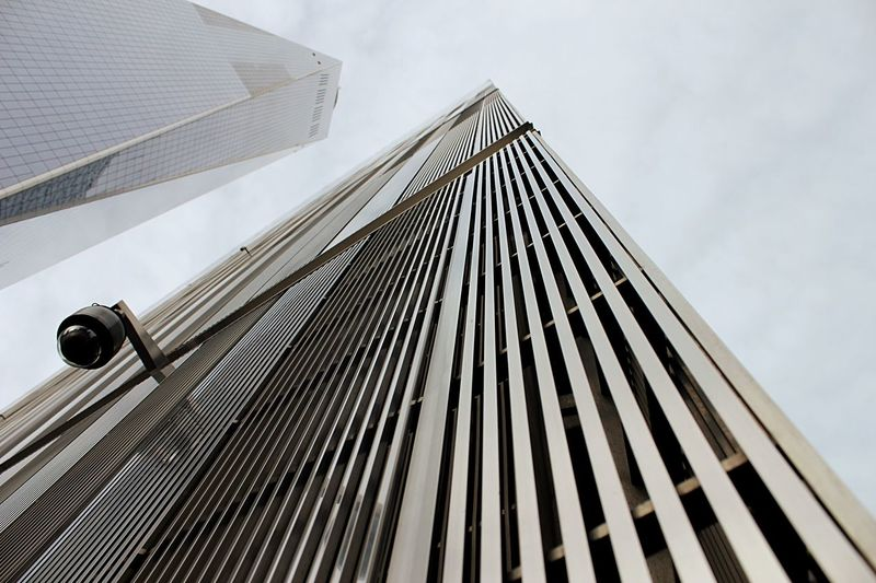 Low angle view of world trade 7 and freedom tower Low Angle Perspective Freedom Tower World Trade 7 EyeEm Selects Low Angle View Architecture Built Structure Sky Building Exterior No People Building Cloud - Sky Day Nature Modern Office Building Exterior Outdoors Tall - High Skyscraper Pattern City Office Sunlight Metal The Architect - 2019 EyeEm Awards