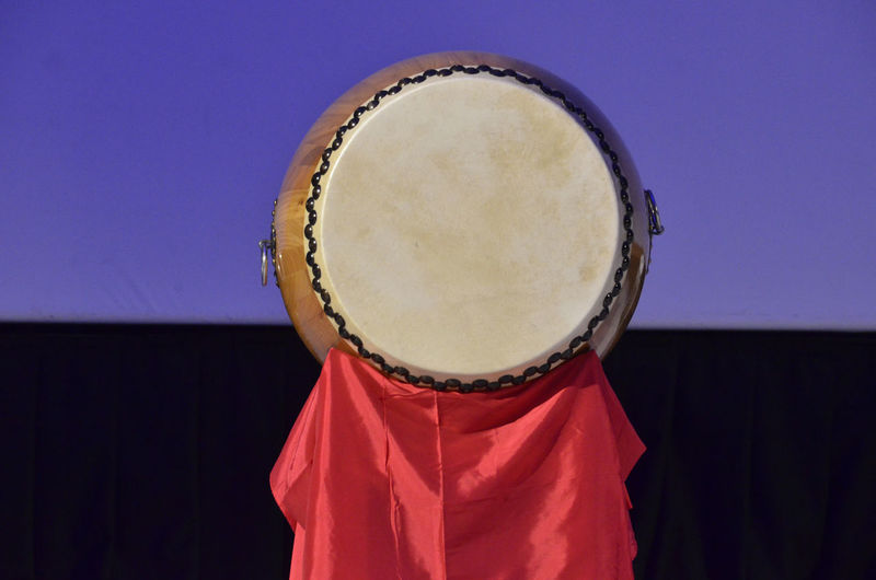 Red fabric hanging from traditional drum