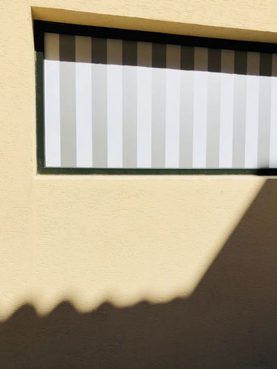 Architecture Building Building Exterior Built Structure Close-up Day Focus On Shadow Low Angle View Nature No People Outdoors Pattern Shadow Sunlight Sunny Wall Wall - Building Feature White Color Window Window Frame Yellow