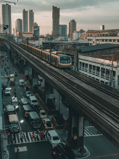 High angle view of train and buildings in city