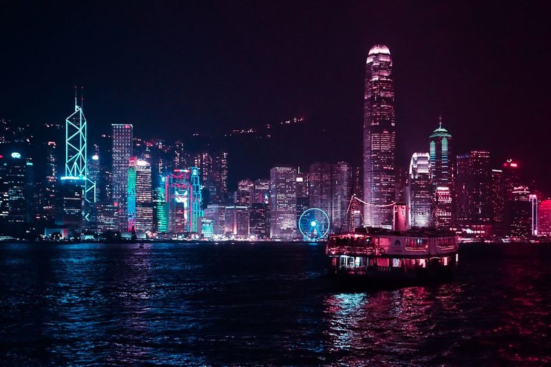 Discover Hong Kong at night City Skyscraper Architecture Modern Night Illuminated Building Exterior Cityscape Urban Skyline Built Structure Waterfront Tower Travel Destinations No People Sea Water Outdoors Downtown District Nautical Vessel Sky HongKong Travel Travel Photography