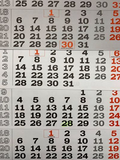 Calendar Date Calendar Photography Calendar Backgrounds Text Full Frame Communication Number No People Paper Close-up Indoors  Non-western Script Information Western Script Script Red Arrangement Choice Information Sign