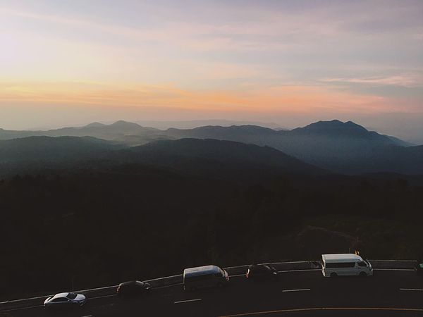 Mountain Car Land Vehicle Mountain Range Transportation Nature Mode Of Transport Beauty In Nature Sunset Outdoors Scenics Sky Beauty In Nature Landscape Travel Lifestyles Sunrise Morning Light Morning Morning Sky The Great Outdoors - 2017 EyeEm Awards
