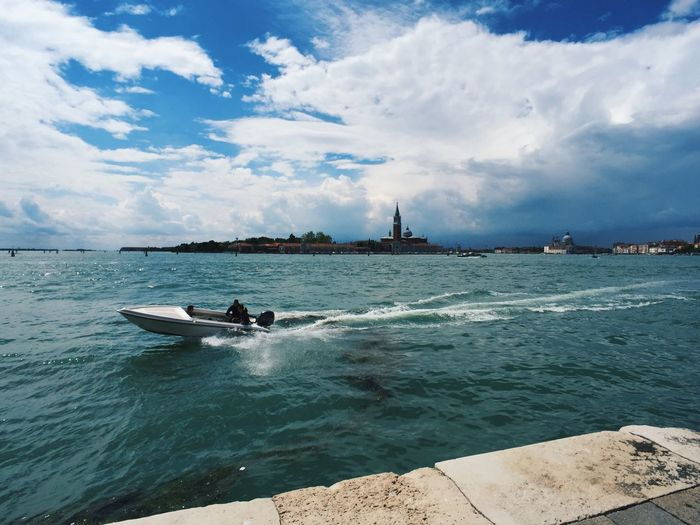 Venice laguna and San Giorgio Maggiore island skyline Visiting Explore Wide Angle View Wide Angle Sunny Italy Travel Destinations San Giorgio Maggiore SanGiorgioMaggiore Skyline Exploring Boat Laguna Di Venezia  Laguna Venice Italy Venezia Venice, Italy Venice Water Cloud - Sky Sky Nautical Vessel Transportation Mode Of Transportation Day Incidental People Outdoors Motion Travel Lifestyles