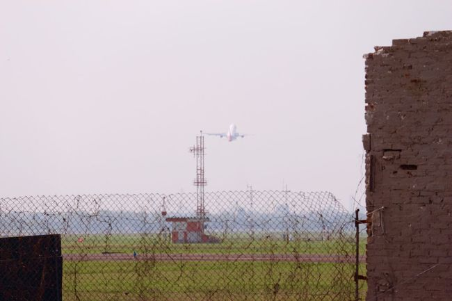 Behind the wire....a taking off Aircraft Airplane Airport Day Outdoors Runaway Sky Taking Off Wire