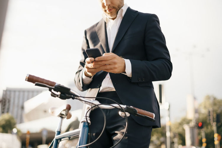 Man riding bicycle on mobile phone