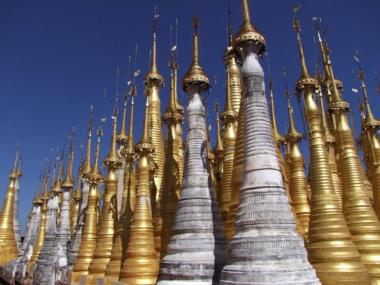 Modern Stupas not fully gilded Blue Sky Buddhism Buddhist Architecture Buddhist Stupas Composition Full Frame Gold Coloured Golden Stupa Inle Lake Kakku Myanmar No People Outdoor Photography Pilgimage Pilgrimagesites Place Of Prayer Place Of Worship Religion Shan State Side By Side Stupa Sunlight And Shadows Tourism Tourist Attraction  Tourist Destination