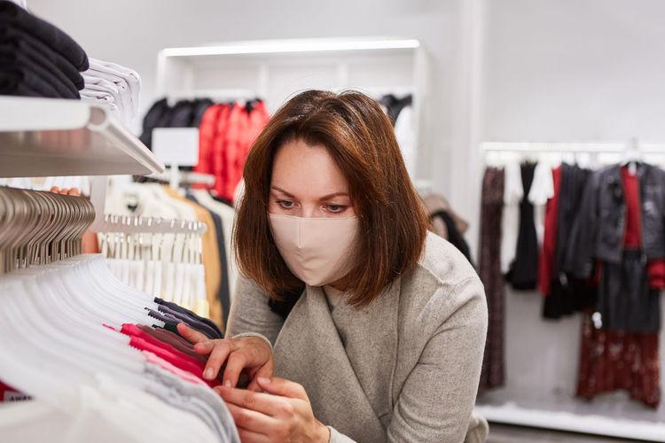 Close-up of woman wearing mask shopping at mall