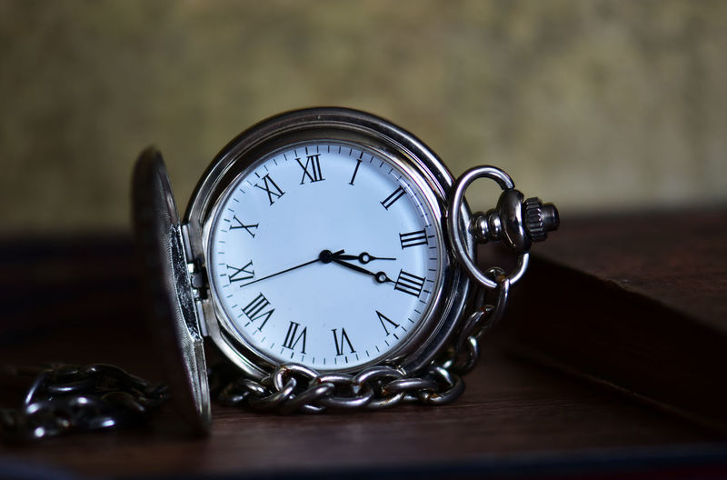 Table Time Clock Still Life No People Indoors  Close-up Wood - Material Number Accuracy Watch Glass - Material Selective Focus Transparent Instrument Of Time Minute Hand Circle Geometric Shape Reflection Antique Clock Face Hour Hand Pocket Watch Personal Accessory Silver Colored