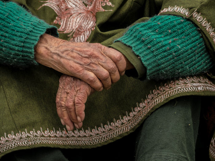 Midsection Of Senior Woman Wearing Green Warm Clothing
