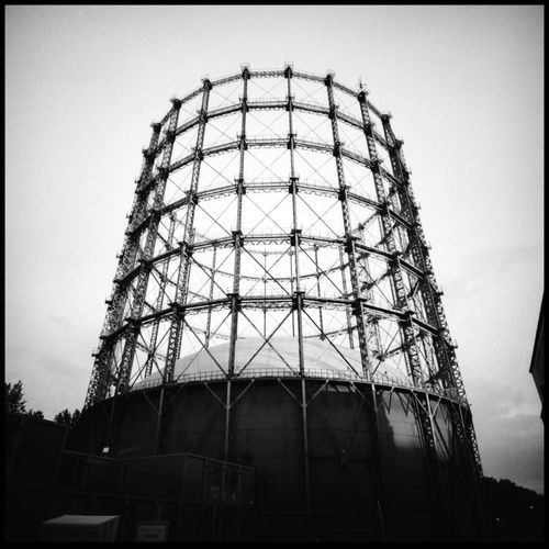 Gasometer and Paper Analogue Photography Architecture Belgium Berlin Black And White Boat Film Photography Garbage Can Gasometer Grain Harbour Harbour Work Ideas Lomography Medium Format Outdoors Paper Balls Paper Trash Plank Port Skeleton The Architect - 2017 EyeEm Awards Trash Travel Water