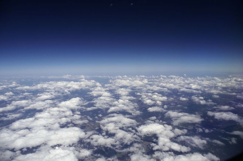 Above Aerial View Airplane Astronomy Backgrounds Beauty In Nature Blue Cloud - Sky Cloudscape Day Environment Flying Heaven Nature No People Outdoors Planet Earth Scenics Sky Sky Only Space Tranquility