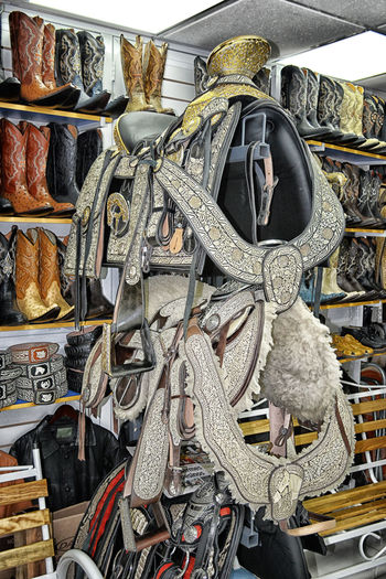 horse saddles Boots Choice Day Hanging Horse Saddles Indoors  Large Group Of Objects No People Retail  Shelf Store Variation Western Style