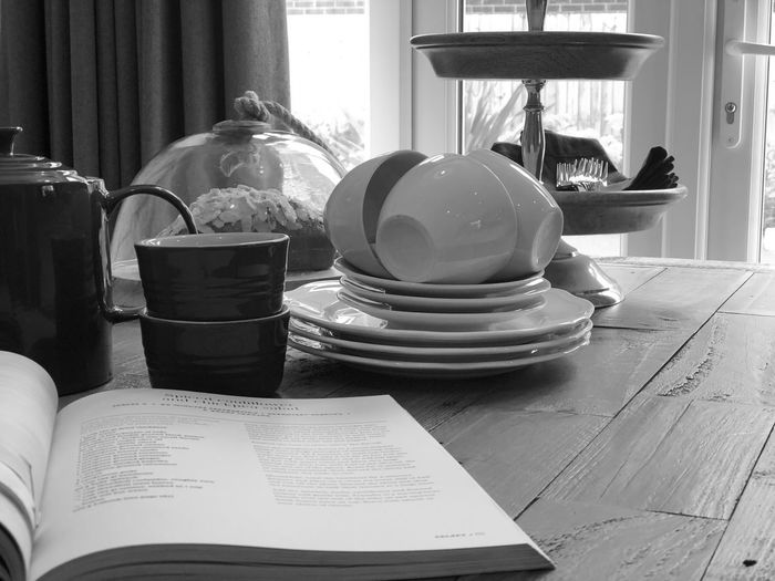 Close-up of open book on table at home
