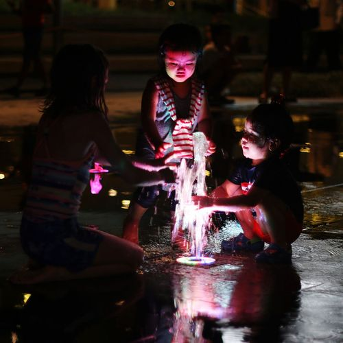 Water light fountain Real People Boys Water Playing Indoors  Reflection Fun Girls Illuminated Night Happiness People First Eyeem Photo