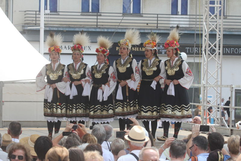 Members of folk group Bistrica from Bistrica, Bulgaria during the 50th International Folklore Festival in center of Zagreb, Croatia on July 22, 2016 Bistrica Bulgaria Celebration Costume Croatia Culture Dance Entertainment Event Festival Folk Folklore Heritage Music Participant Perform Style Tradition Zagreb