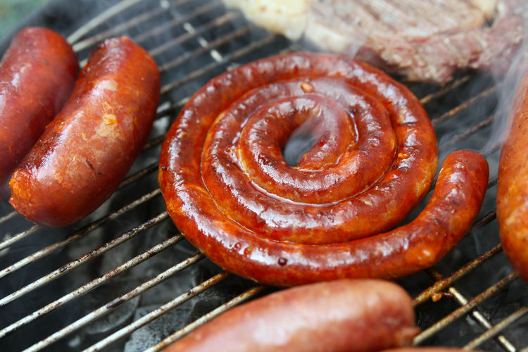 Close-up of sausage on barbecue grill