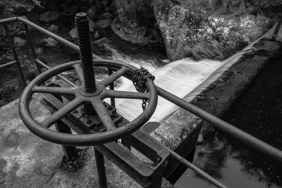 Blacka And White Close Up Day Detail Fence Forest Gears Hydroelectric Power Machinery Manual Metal Monochrome Nature Nature No People Old Outdoors Perspective Rocks Spillway Water