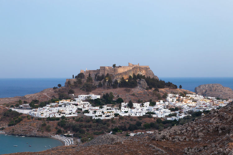 Lindos with acropolis in the evening. Water Sea Architecture Sky Travel Destinations Outdoors Greece Rhodos Lindos Acropolis Lindian Evening Travel Holidays Vacations