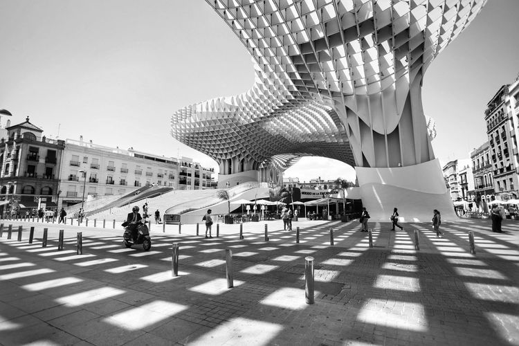Spots of the shadow Black And White City Streetphotography Travel Travel Photography Photography EyEmNewHere #The Week On EyeEm #The Graphic City Architecture SPAIN Andalucía Sevilla Large Group Of People Travel Destinations Architecture City Built Structure People Building Exterior The Graphic City
