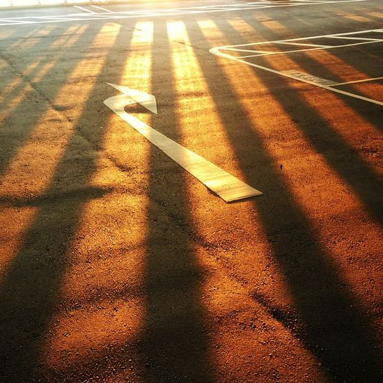 High angle view of shadow on road at sunset