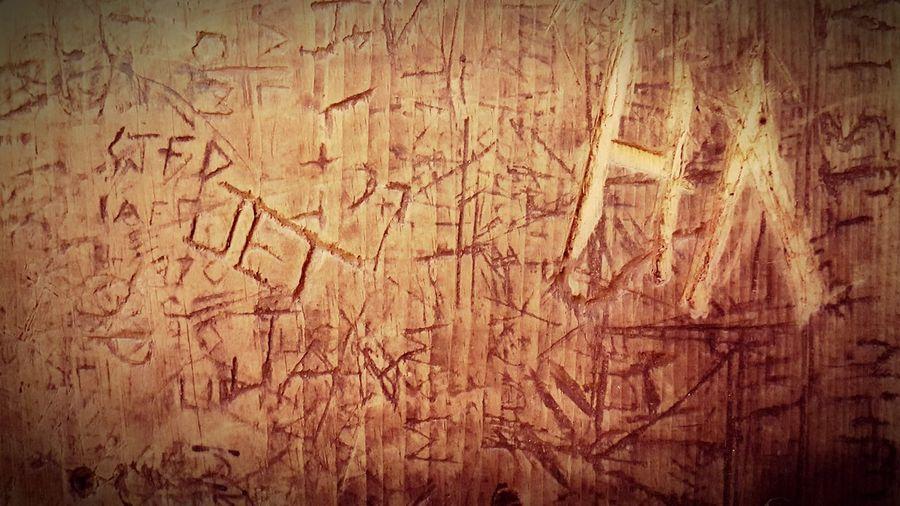 Table graffitti at Gruene Hall, Tx Textured  Brown Backgrounds Brown Background Pattern Wood Grain No People Cellphone Photography Texas Gruene TX Gruene Hall History Dancehall Graffiti