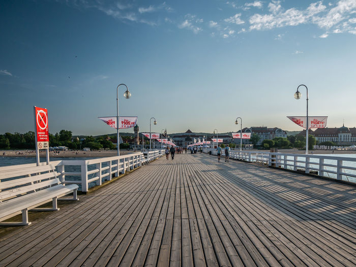 View of pier over street against sky