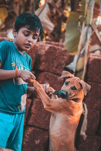 Portrait of a man holding dog