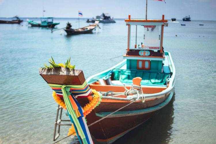 Wooden taxi boat At the beach On Nangyuan island thailand Travel is land Beach Beauty In Nature Day Fishing Boat Focus On Foreground Mode Of Transportation Moored Nature Nautical Vessel No People Outdoors Scenics - Nature Sea Sky Transportation Travel Travel Destinations Water Waterfront
