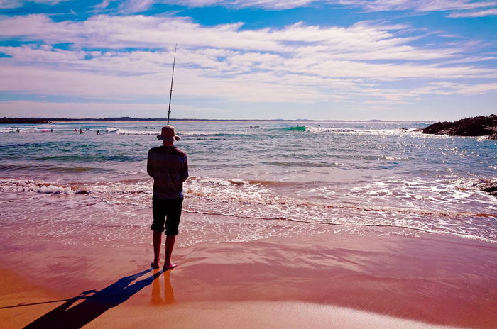Fishing on beach. Beach One Man Only Sea Sand Only Men Sky Full Length One Person Water Outdoors Rear View Adult Standing Summer People Reflection Horizon Over Water Adults Only Vacations Fishing Australia Angler Port Macquarie