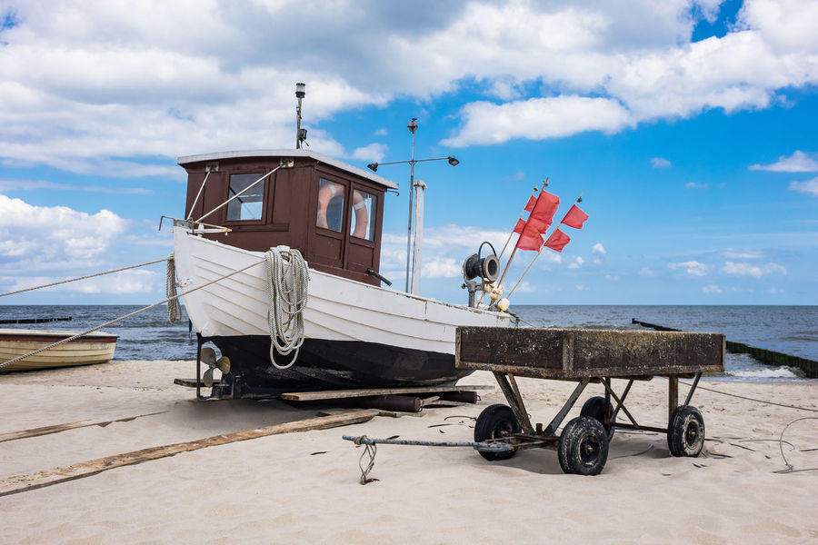 Fishing boat on the Baltic Sea coast. Baltic Sea Holiday Relaxing Beach Beauty In Nature Cloud - Sky Coast Day Fishing Boat Horizon Over Water Journey Koserow Landscape Nature No People Outdoors Sea Shore Sky Tourism Travel Destinations Usedom Vacation Water