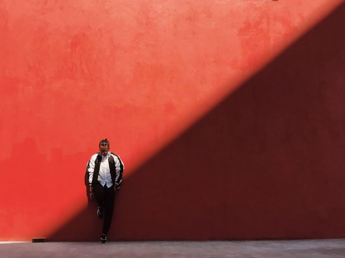 Light Slice - Red Real People Standing One Person Men Outdoors Day Light Self Portrait Light And Shadow Shadow Sunlight Backgrounds Diagonal Minimal Wall My Year My View Simple Minimalism Look Down EyeEm Best Shots Eye4photography